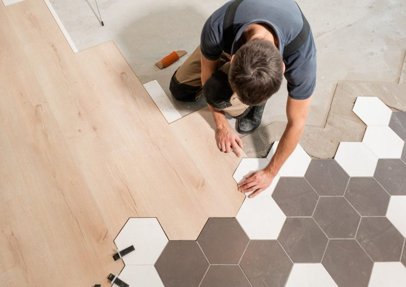 The combination of wood panels of laminate and ceramic tiles in the form of honeycomb. Kitchen renovation.